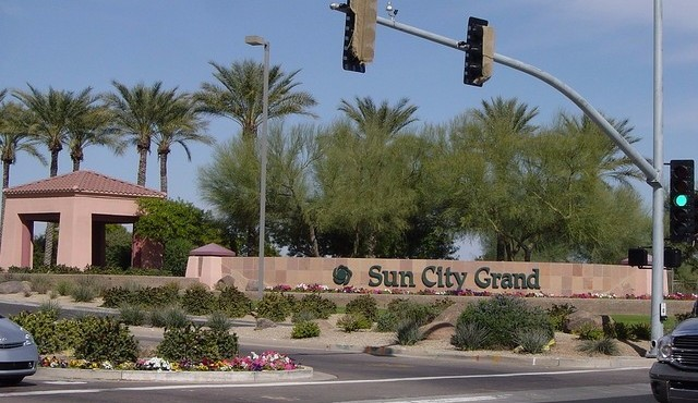 Entry sign for Sun City Grand in Surprise Arizona